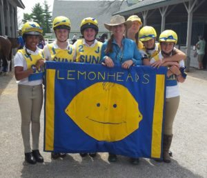 Ashley and Pony Club team with her mother behind