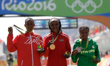 Jemima Sumgong of Kenya, Mare Dibaba of Ethiopia and Eunice Jepkirui Kirwa of Bahrain pose