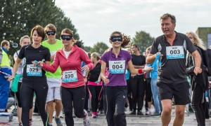 Visually Impaired Runners with Guides